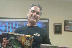 David Cohen holding donated toys