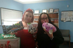 Greter and Barbie showing fun gifts donated for Toy Drive