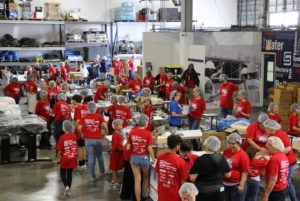 Super Restoration staff helped pack enough meals to feed 3307 children for a year